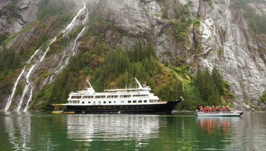 UnCruise-sen-misty-cliff-waterfall-skiff